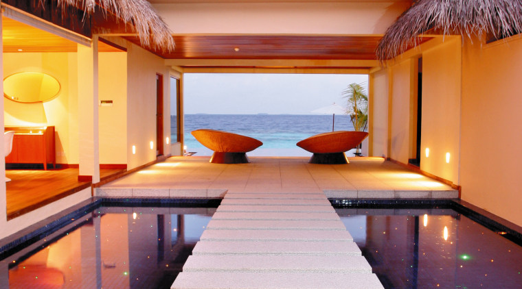 A viewof a beach bungalow. architecture, estate, home, hotel, house, interior design, lighting, real estate, swimming pool, wood, orange
