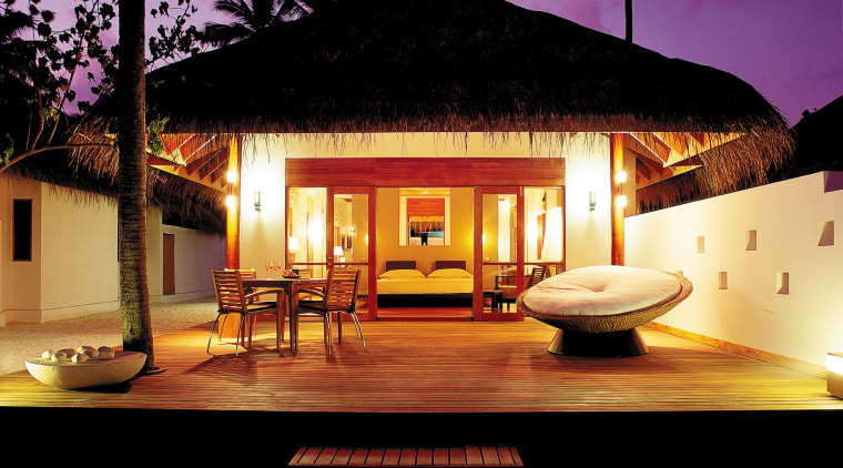A viewof a deluxe beach bungalow. estate, home, house, lighting, property, real estate, resort, villa, black