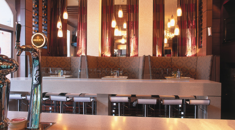 view of the bar and seating areas featuring countertop, interior design, lighting, restaurant, orange