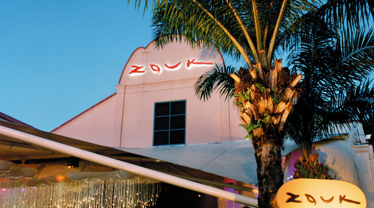 view of the exterior of the zouk nightclub arecales, lighting, palm tree, plant, sky, tree, black