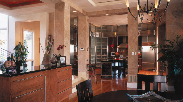 A view of the kitchen and didning areas. ceiling, dining room, interior design, lobby, real estate, room, brown, black