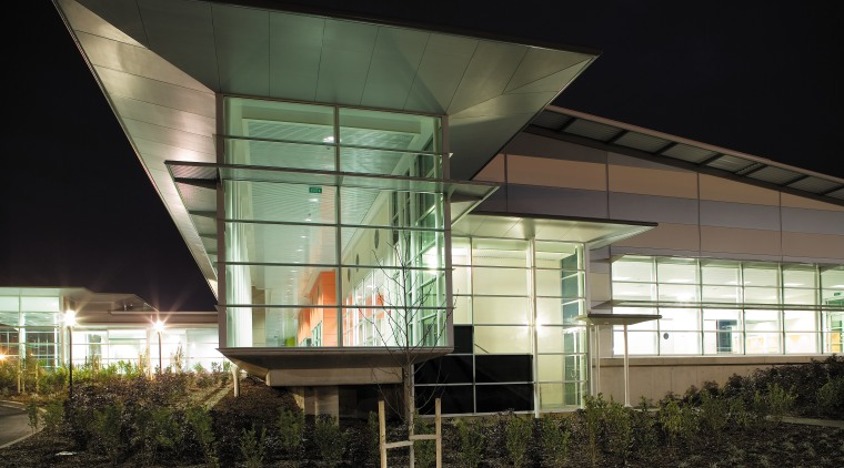 A view of the outdoor lighting. architecture, building, corporate headquarters, facade, house, mixed use, black