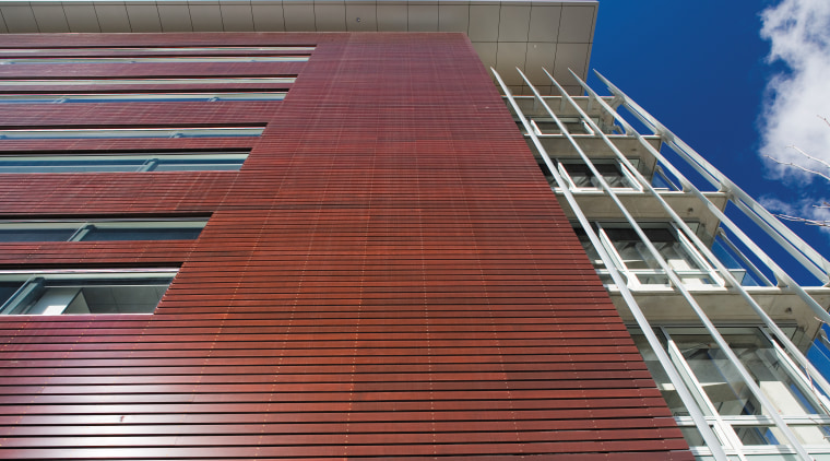 An exterior view of the cedar cladding. architecture, brick, brickwork, building, commercial building, corporate headquarters, daylighting, daytime, facade, landmark, line, roof, siding, sky, structure, wall, wood, red