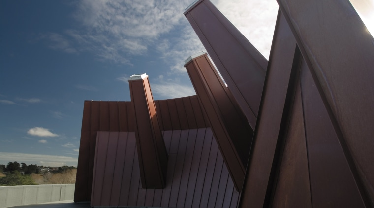 A view of the copper clad roofing. angle, architecture, cloud, daylighting, house, line, reflection, sky, sunlight, wood, black