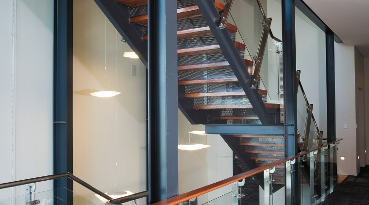 A view of the stairway. architecture, daylighting, glass, handrail, house, stairs, structure, black, gray