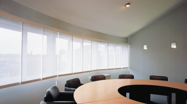 A view of some window shades. architecture, ceiling, conference hall, daylighting, interior design, office, table, window, gray