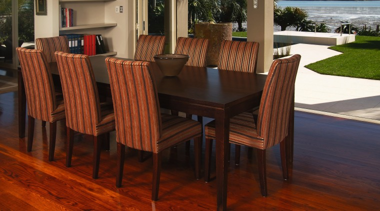 A view of some furniture from Nobelwood. chair, dining room, floor, flooring, furniture, hardwood, kitchen & dining room table, laminate flooring, table, wood, wood flooring, wood stain, red