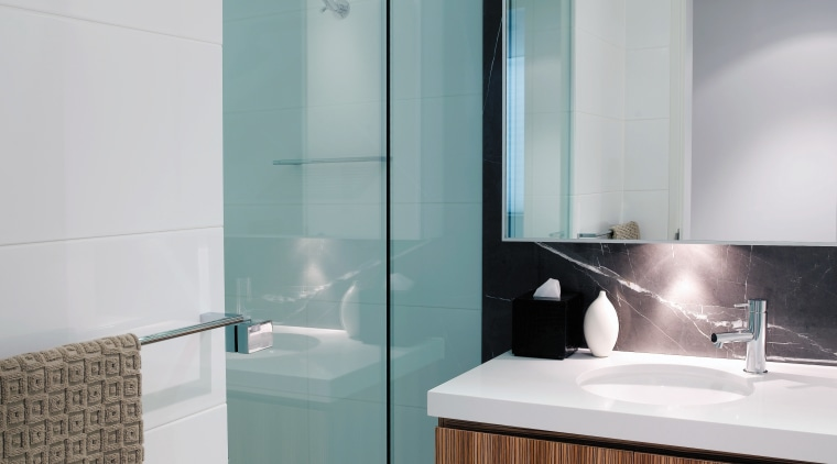 A view of a shower screen from Erina bathroom, bathroom accessory, bathroom cabinet, floor, glass, interior design, plumbing fixture, product design, room, sink, tap, tile, gray