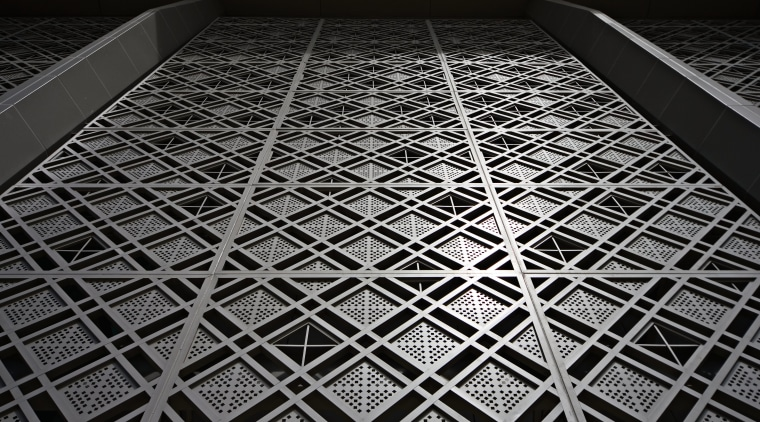 exterior view of this   metal facade architecture, black, black and white, daylighting, design, light, line, material, mesh, metal, monochrome, monochrome photography, pattern, structure, symmetry, black, gray