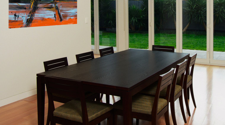 A view of some furniture from Neo Design. chair, dining room, floor, flooring, furniture, hardwood, interior design, table, wood, brown, gray