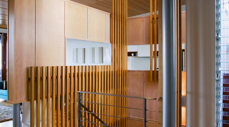 view of the hall/stairway featuring timber flooring, steel architecture, ceiling, floor, flooring, hardwood, house, interior design, lobby, real estate, stairs, wood, wood flooring, brown