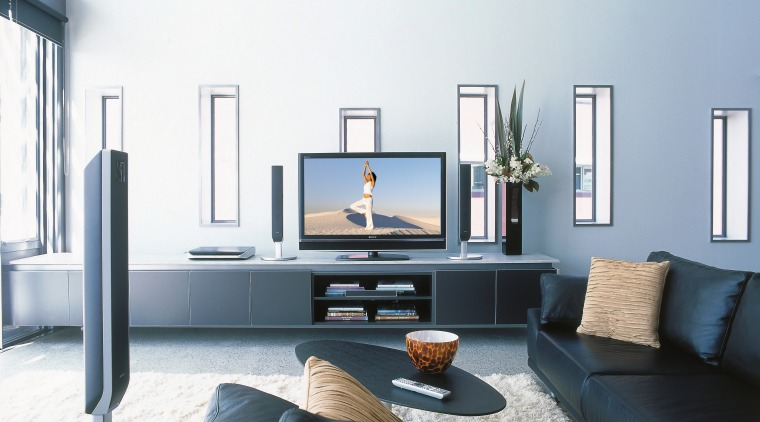 A view of a home entertainment system from furniture, interior design, living room, room, table, white, black