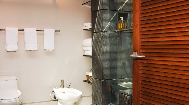 A view of a bathroom designed by David bathroom, floor, flooring, home, interior design, room, wall, brown, white