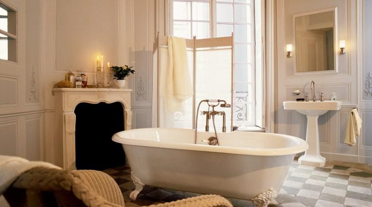 A view of some faucetry from Hansgrohe. bathroom, bathtub, floor, flooring, home, interior design, plumbing fixture, room, sink, window, brown