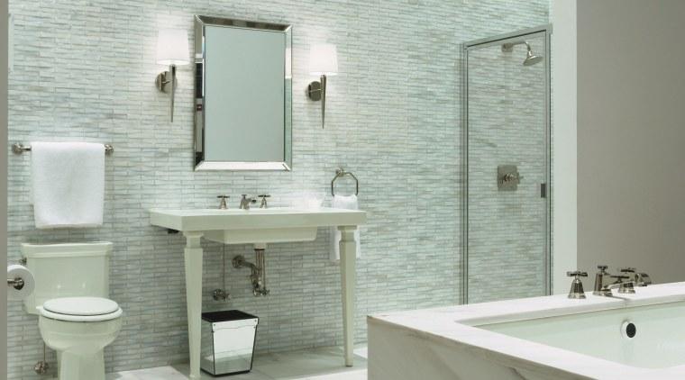 view of the new Kohler Chicago store showcasing bathroom, bathroom accessory, bathroom cabinet, bathroom sink, ceramic, floor, interior design, plumbing fixture, product design, room, sink, tap, tile, wall, gray