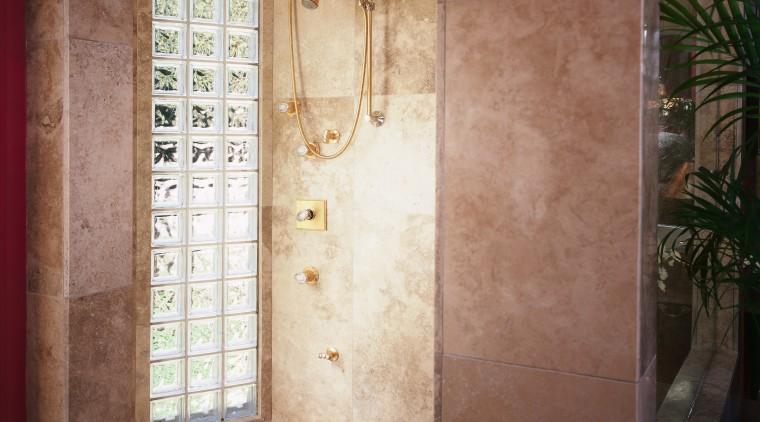 A view of the shower stall. bathroom, door, floor, flooring, home, interior design, plaster, plumbing fixture, room, tile, wall, window, brown