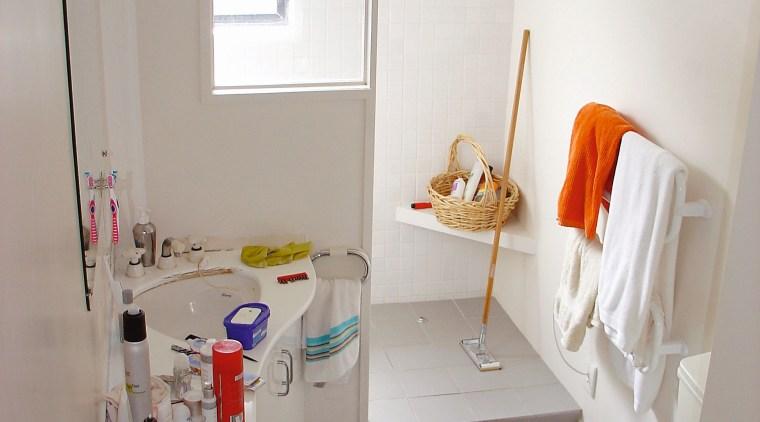 The original angular cabinetry tookn up floor space bathroom, floor, home, interior design, plumbing fixture, product design, room, sink, gray