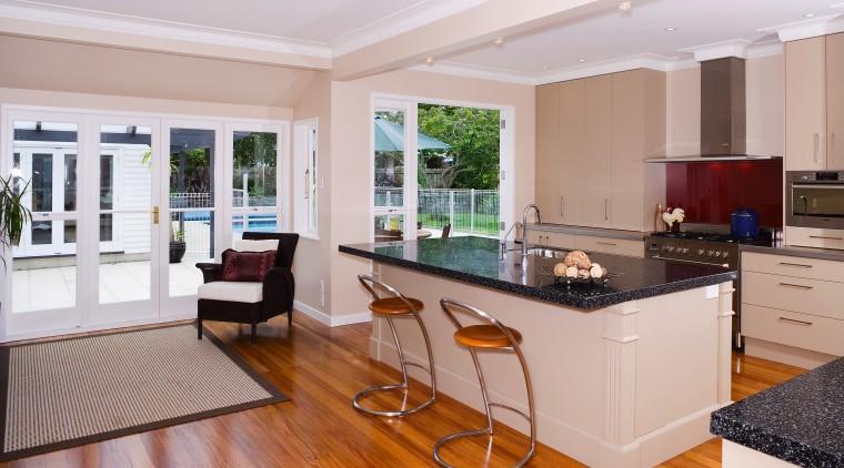 A view of the kitchen area, wooden flooring, countertop, floor, flooring, interior design, kitchen, real estate, room, window, gray