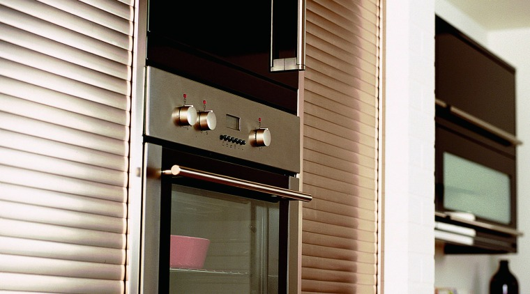 Close up view of the multi function ovens door, furniture, interior design, window, window covering, white, black