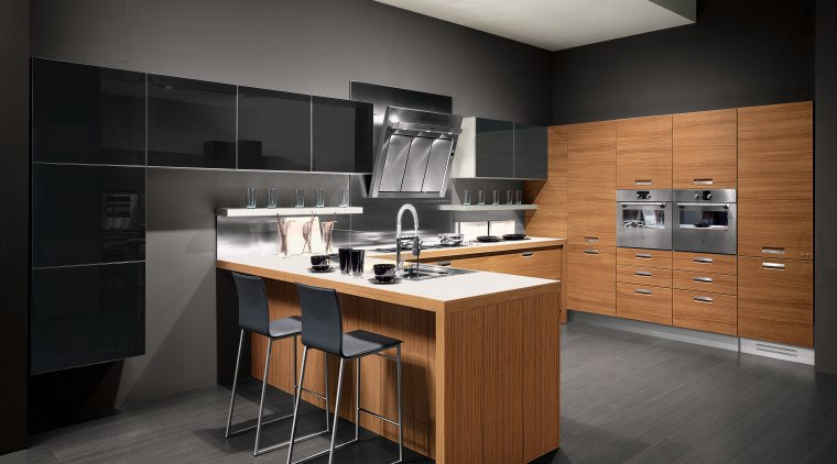 View of kitchen with wood grain cabinetry, grey cabinetry, countertop, cuisine classique, floor, furniture, interior design, kitchen, product design, room, black
