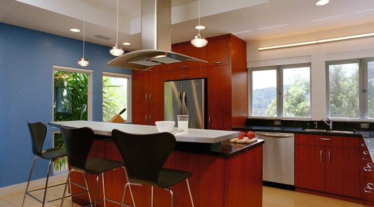 A view of this contemporary kitchn featuring gherry cabinetry, ceiling, countertop, flooring, interior design, kitchen, real estate, room, gray