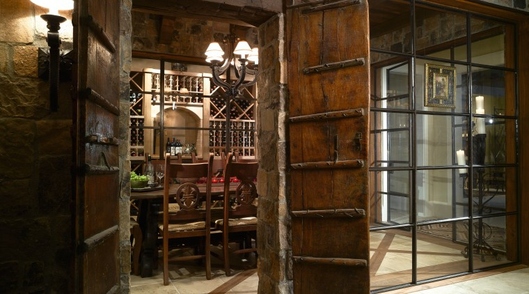 Interior view of home showing timber doors and door, interior design, window, brown
