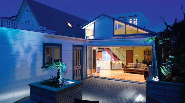 Exterior view of the renovated house and outdoor architecture, cottage, estate, facade, home, house, lighting, property, real estate, residential area, roof, sky, villa, window, blue
