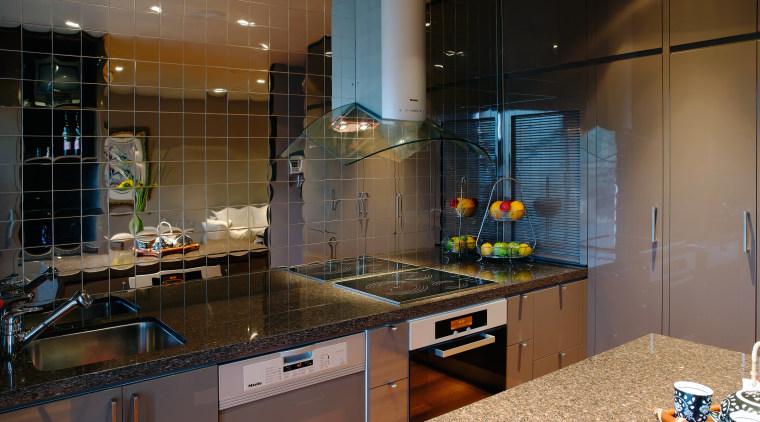 A vie wof some alloy kitchen tiles by countertop, interior design, kitchen, room, under cabinet lighting, black, brown