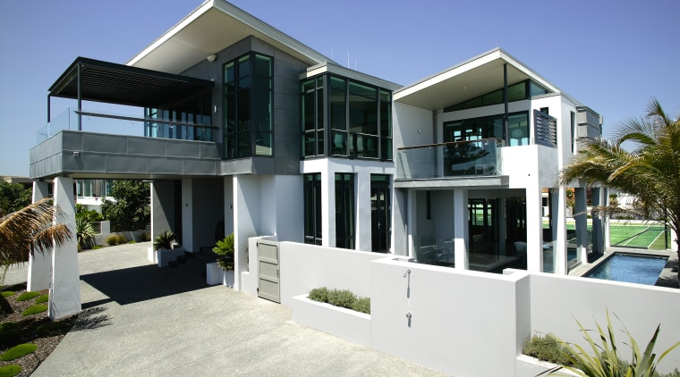 Exterior view of this house at Mt Maunganui architecture, building, elevation, estate, facade, home, house, property, real estate, residential area, villa, window, white