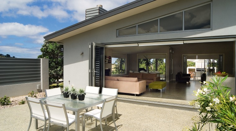 A view of a home by GJ Gadiner estate, home, house, outdoor structure, patio, property, real estate, window, gray