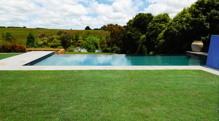 A view of a swimming pool by Pleasure area, backyard, estate, grass, house, lawn, leisure, plant, property, real estate, swimming pool, villa, water, yard, green, white