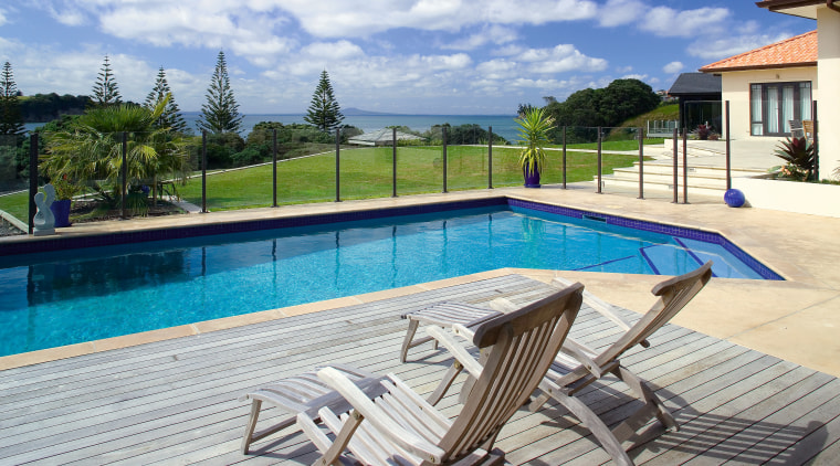 View of this concrete pool designed and manufactured condominium, estate, home, house, leisure, leisure centre, outdoor furniture, outdoor structure, property, real estate, resort, sunlounger, swimming pool, vacation, villa, water