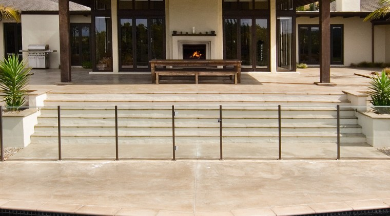 A vie wof some pavers by Peter Fell. deck, estate, facade, home, house, outdoor structure, swimming pool, villa,