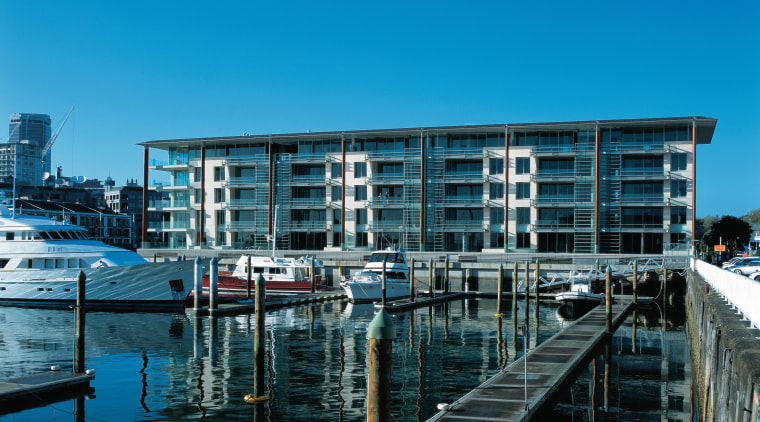 An exterior view of the lighter quay apartment architecture, building, city, condominium, corporate headquarters, dock, harbor, marina, mixed use, real estate, reflection, sky, water, water transportation, waterway, teal
