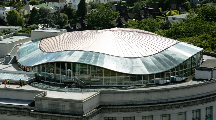 A view of the copper roof installed on architecture, arena, building, corporate headquarters, daylighting, daytime, landmark, metropolitan area, roof, sport venue, stadium, structure, black