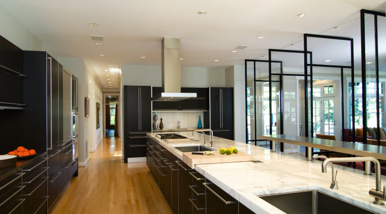A view of this kitchen featuring maple flooring, countertop, interior design, kitchen, real estate, room, white