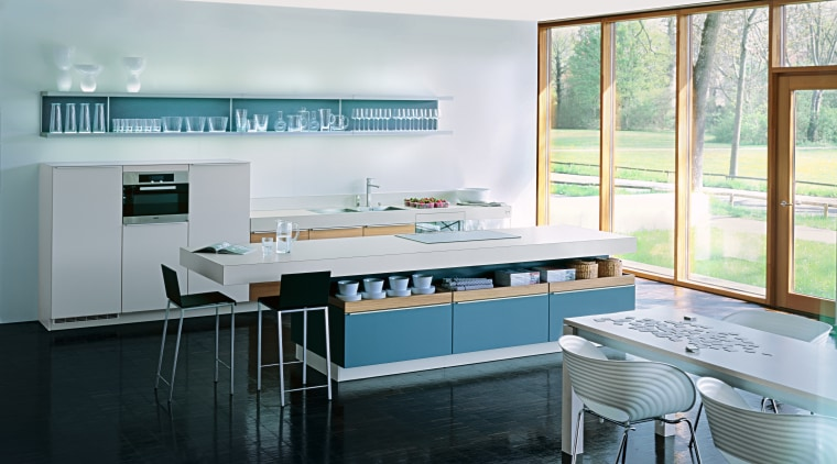 A view of a kitchen by Poggenphol Kitchens. countertop, interior design, kitchen, room, table, window, white, black