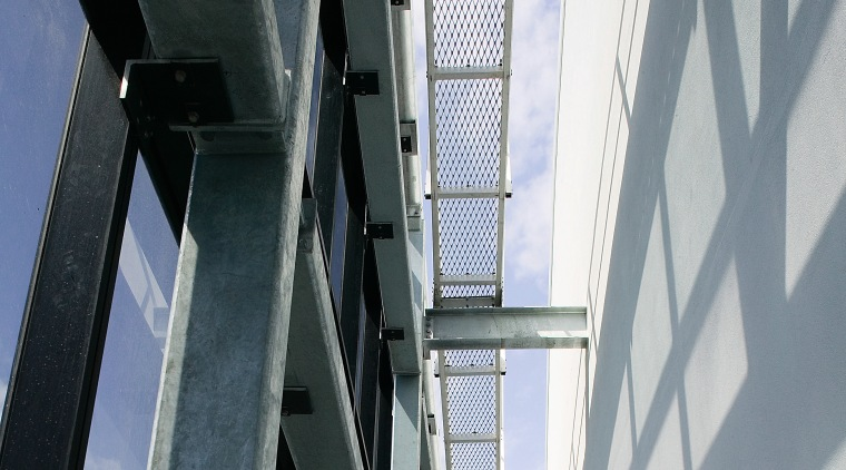 A view of the structural steel manufactured and architecture, building, daylighting, daytime, facade, glass, line, steel, structure, window, gray, black, white