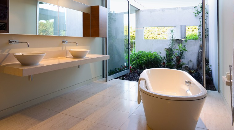 The physical presence of the bath and the architecture, bathroom, floor, home, interior design, real estate, room, gray, white