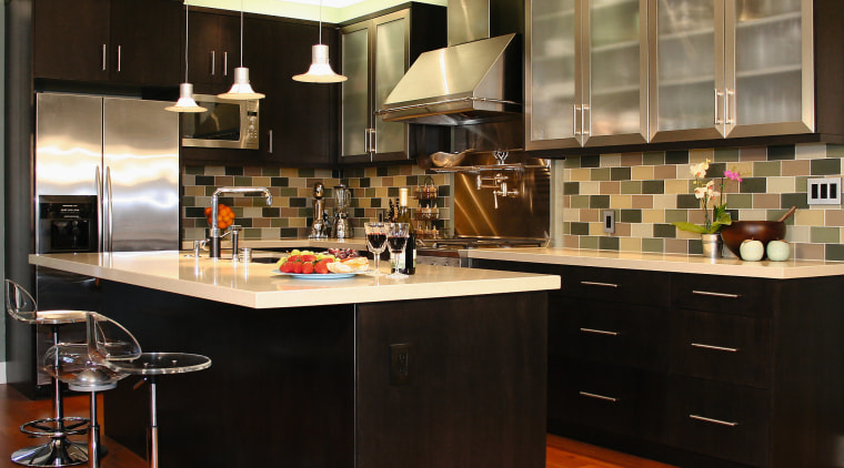 View of this kitchen featuring stained timber flooring, cabinetry, countertop, cuisine classique, interior design, kitchen, room, black, brown