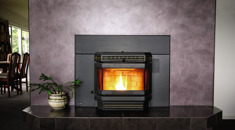 A view of a fireplace from Nature's Flame. fireplace, hearth, heat, home appliance, wood burning stove, gray, black