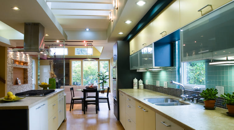 A view of this modern kitchen designed by ceiling, countertop, interior design, kitchen, real estate