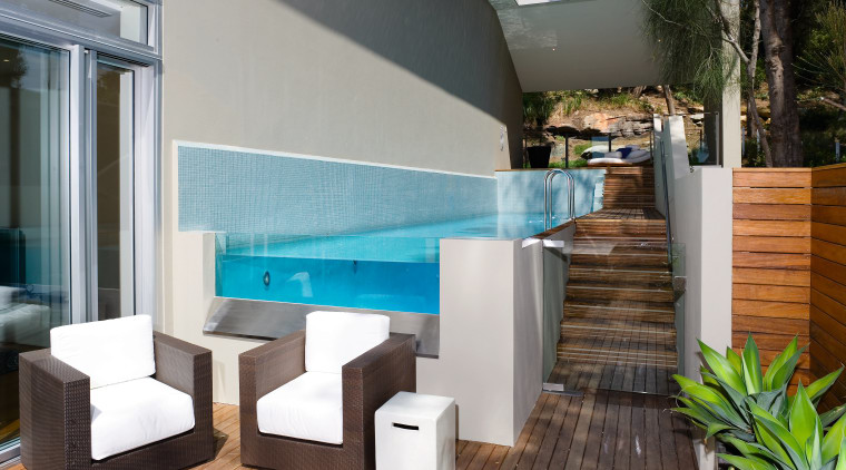 A view of a home developed by Lend architecture, furniture, house, interior design, property, swimming pool, table, gray