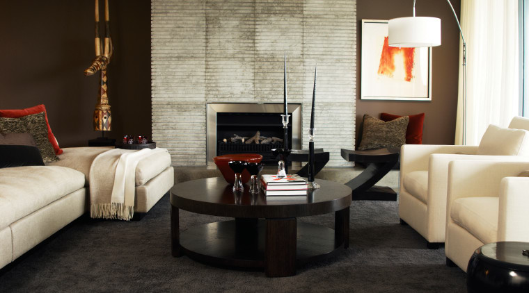A view inside this sub-penthouse, contemporary elements, such coffee table, couch, floor, flooring, furniture, hearth, home, interior design, living room, loveseat, room, table, wall, black, white