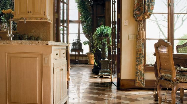 A view of the kitchen an liing areas floor, flooring, hardwood, home, interior design, laminate flooring, living room, lobby, tile, window, wood, wood flooring, brown