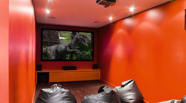 A view of an home theatre system witch ceiling, home, interior design, orange, room, wall, red