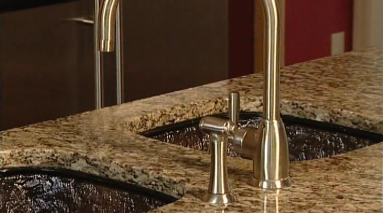 A view of this kitchen featuring a JSG countertop, plumbing fixture, sink, tap, brown