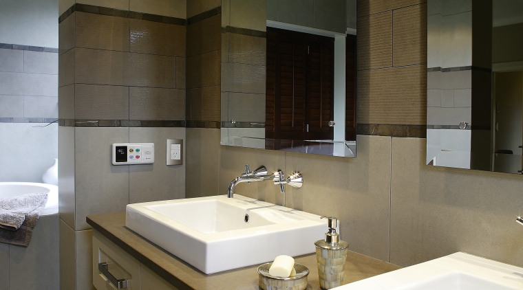 A view of the bathroom featuriing underfloor heating, architecture, bathroom, countertop, interior design, room, sink, brown