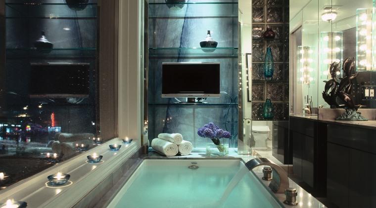 A close up of the bath tub in bathroom, countertop, glass, interior design, black