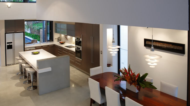 A view of the kitchen area featuring polished furniture, interior design, living room, product design, table, gray